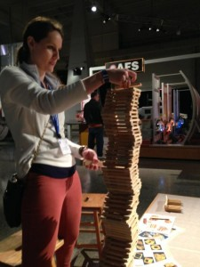 Mary Jo Galbraith plays with science at the US Space and rocket Center. Photo by Angela Rhodes