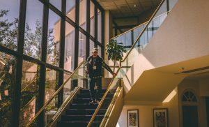 person descending staircase