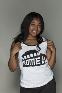 Girl showing off her Rome white tank