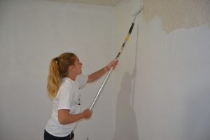 Tennis player painting walls