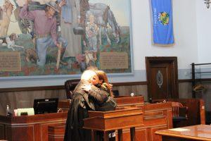 Judge Collins hugging her retired colleague