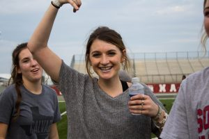 A girl smiling at Siren with a water bottle in hand