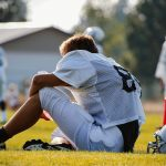 Football player sitting on sideline