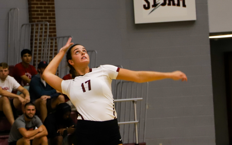 Volleyball player jumping to serve