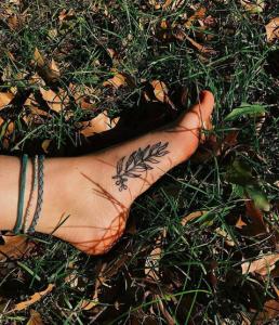 Bridgette Ross's foot tattoo on grass