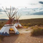 Teepees on the side of the road