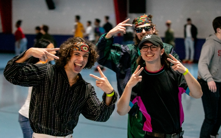 Three students dressed as hippies at Roller Rag
