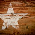 Texas star painted on a wooden wall.