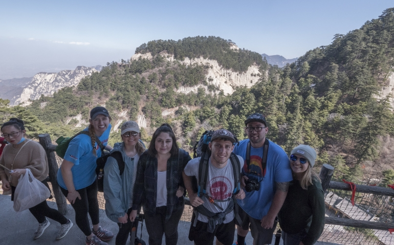 another picture of students standing on a mountain