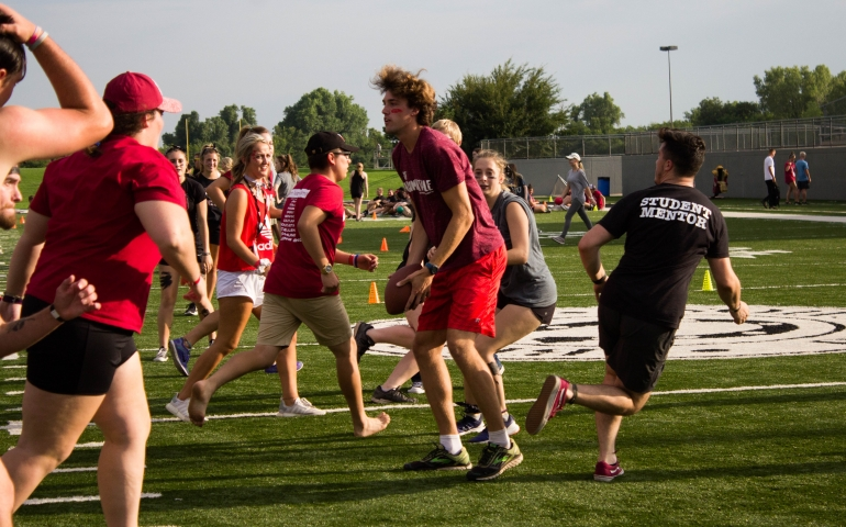 Students and mentors run during games at Siren