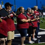 Woodwind section playing outside on SNU's football field