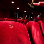Red, velvet seats at a theater