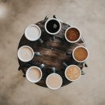 Different colors of coffee on a table in a circle
