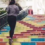 Girl running up stairs outside