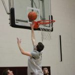 A student going to shoot a lay up