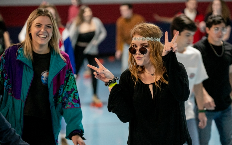 Two students posing as hippies at Roller Rag