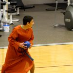 Student in a robe getting ready to throw a dodgeball