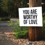 """Sign that says """"You are worthy of love"""""""